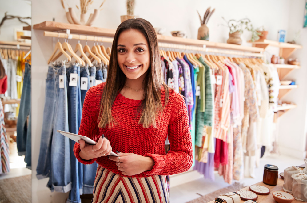 Lady in retail store smiling image
