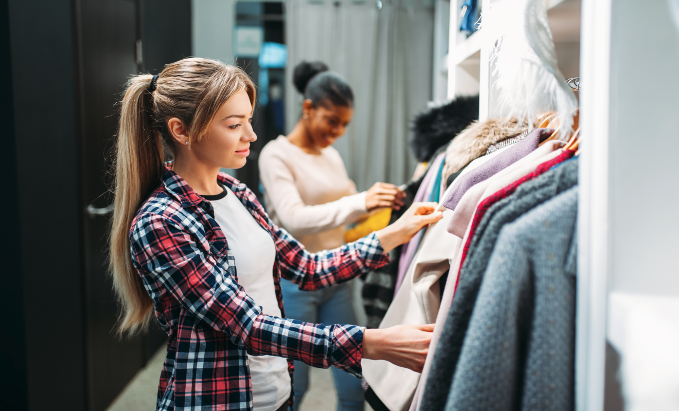 Ladies looking through clothing in a store image