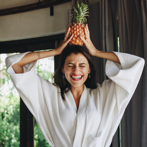 Lady laughing with pineapple on her head image