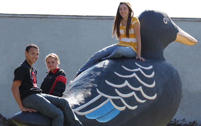 youth on original black duck statue