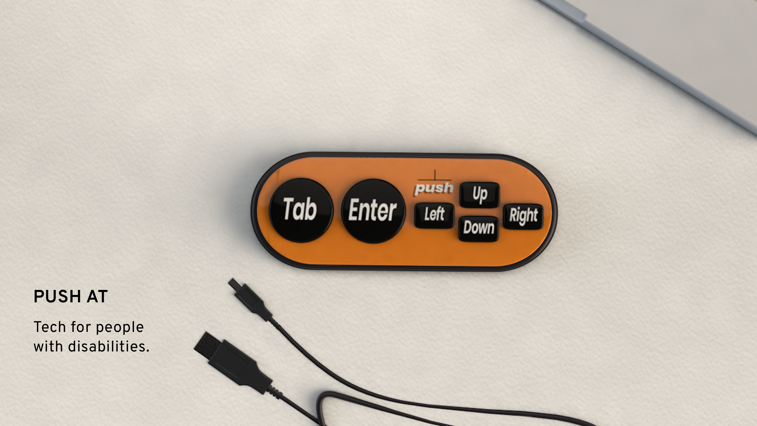 The orange Push device next to a laptop and micro USB chord