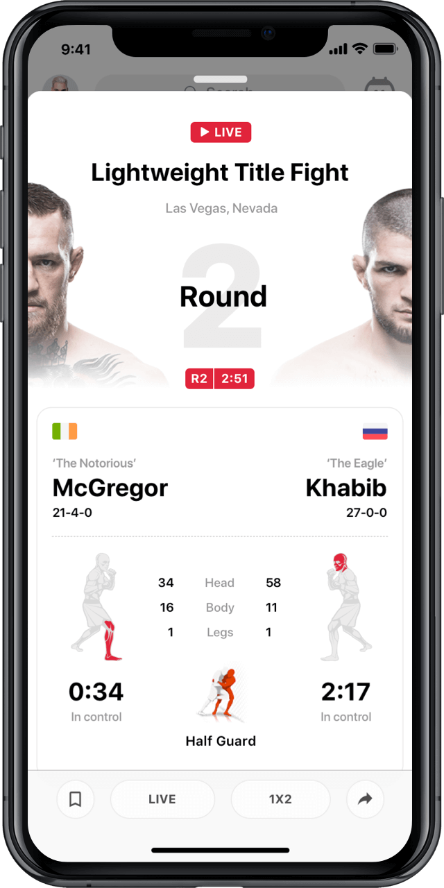 Iphone with live UFC match statistics modal