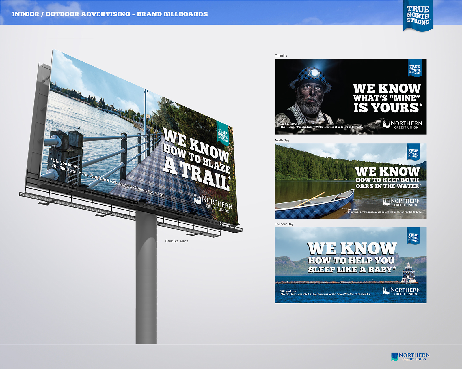 Billboard showing a plaid-covered lake side walking path with a railing.
