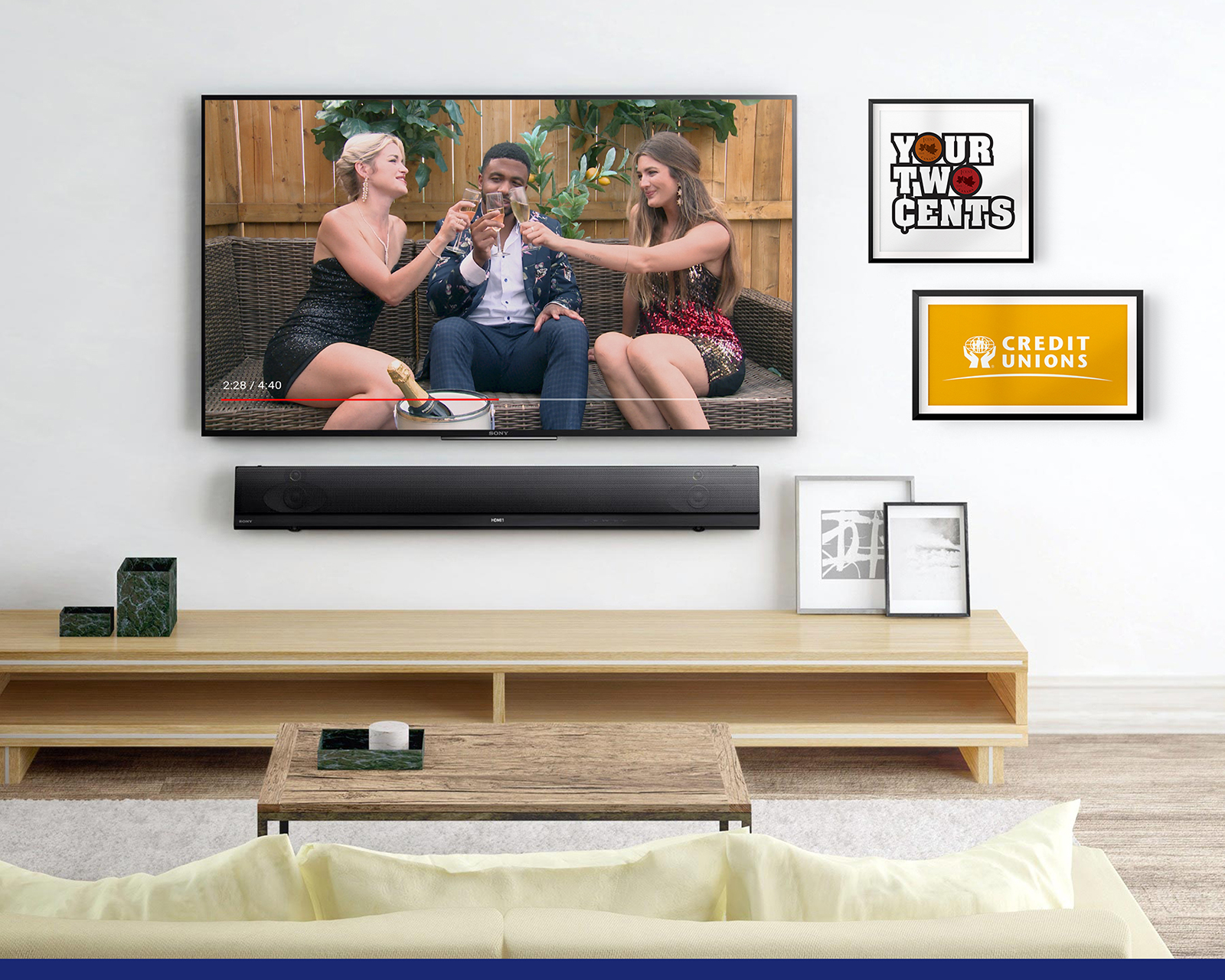 A living room with a TV showing two women toasting a male in the middle.
