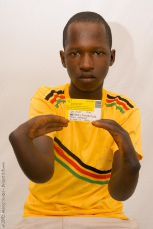 Mamadou with his screening card for Mercy Ships