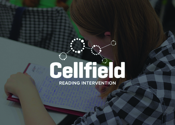 A girl doing schoolwork with the cellfield logo