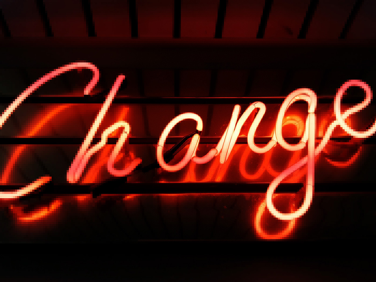 "A neon sign with the ""change"" in red"