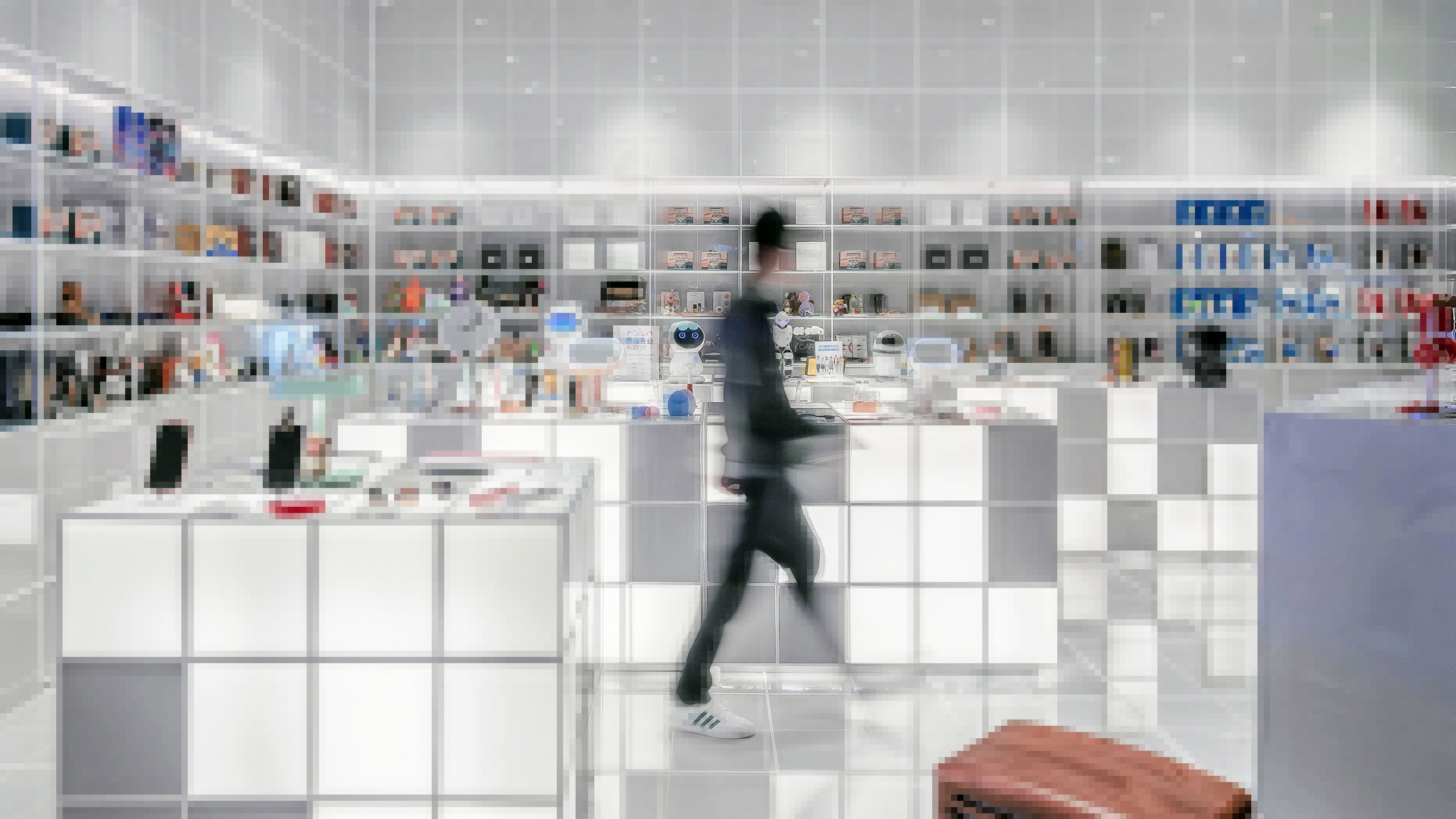 A person is walking around a modern store