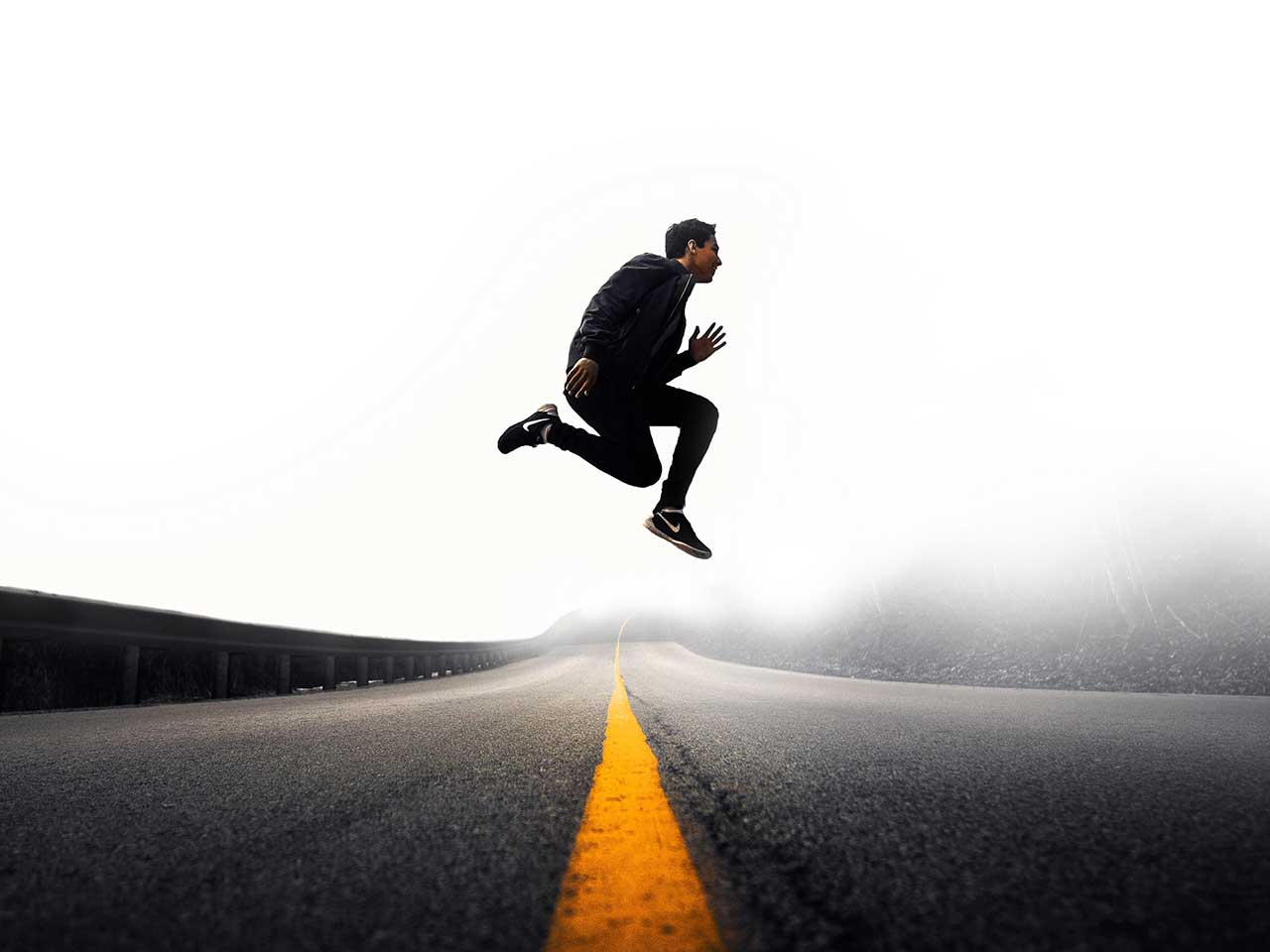 man jumping high in the road