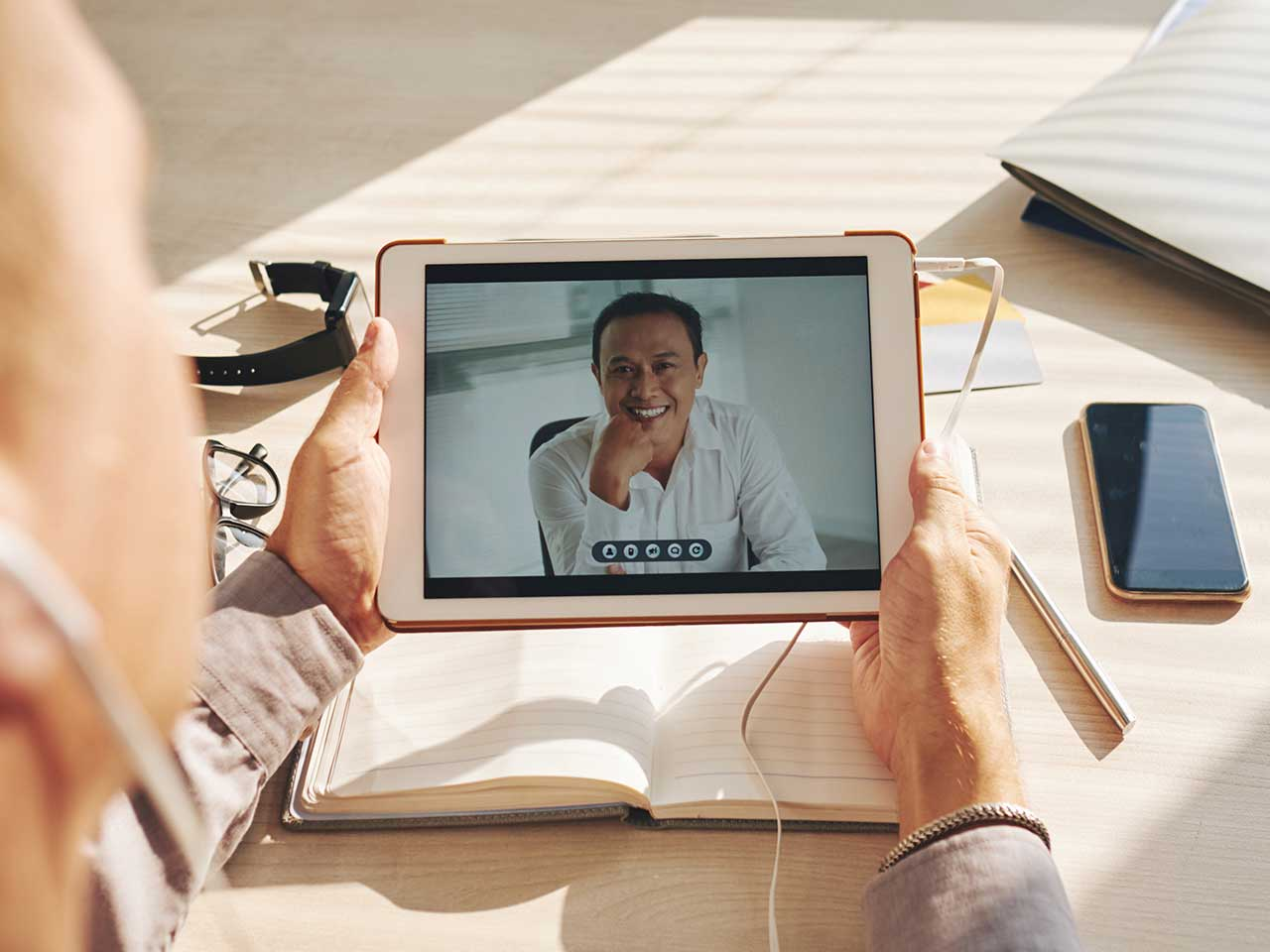 Two home-based workers doing video chat
