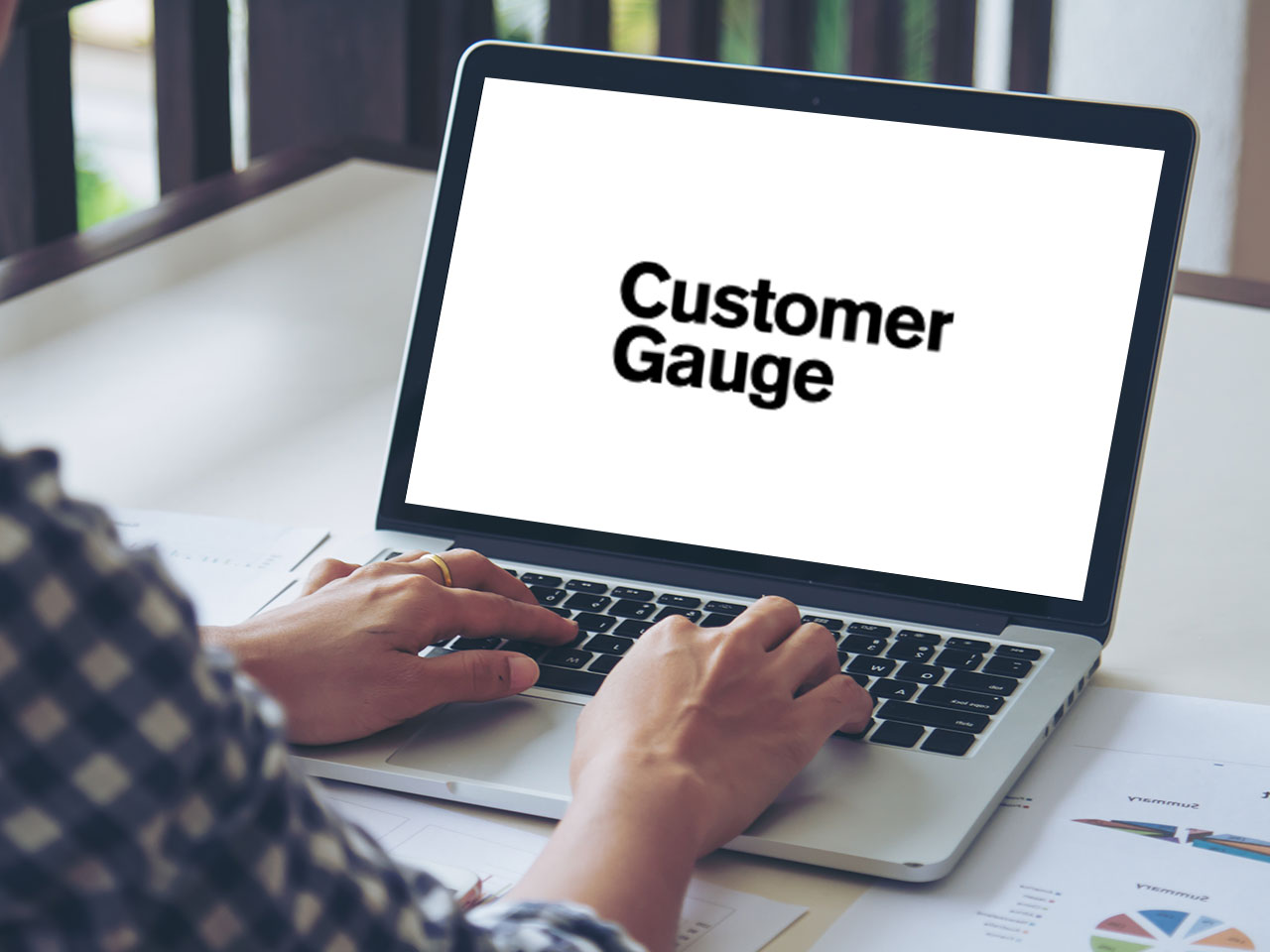 laptop screen with CustomerGauge logo