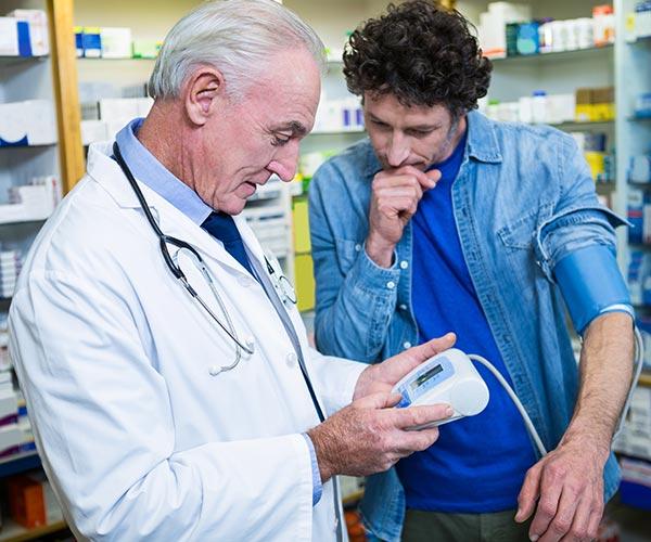 pharmacist-checking-blood-pressure