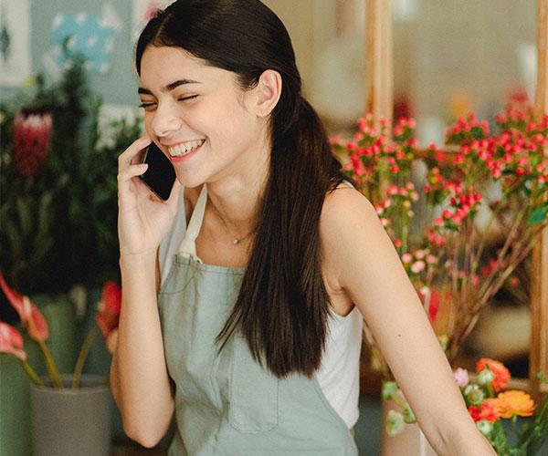 smiling-woman-speaking-on-phone