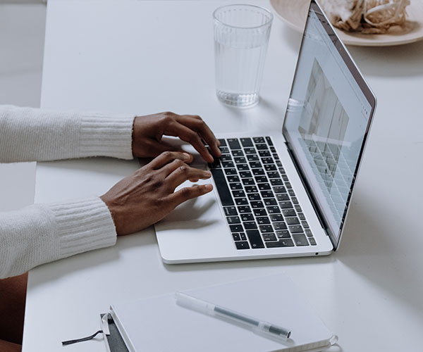 person-in-white-long-sleeve-shirt-using-macbook-pro