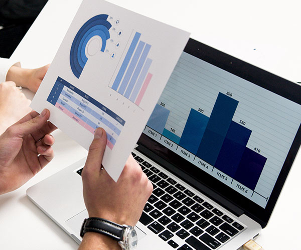 person-holding-paper-with-graph