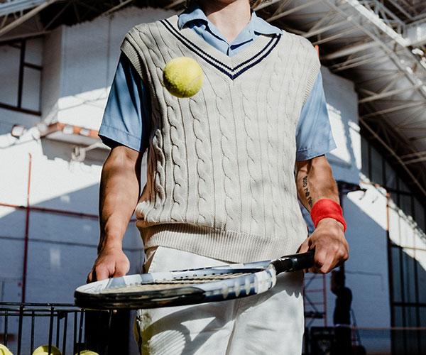 holding-a-tennis-racket