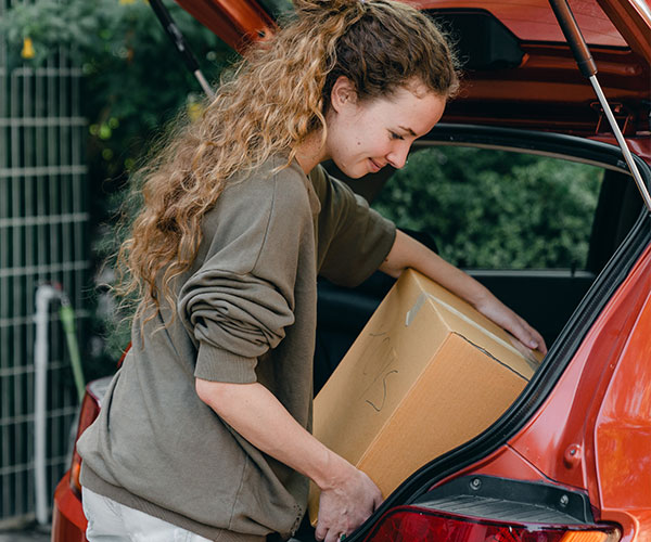 woman-unpacking-car