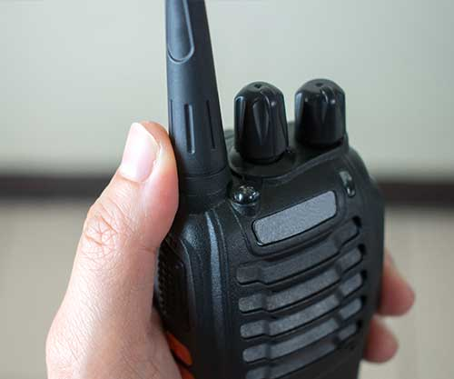 close-up-hand-using-radio-communication