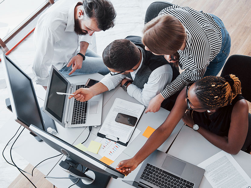 group multinational busy people working office