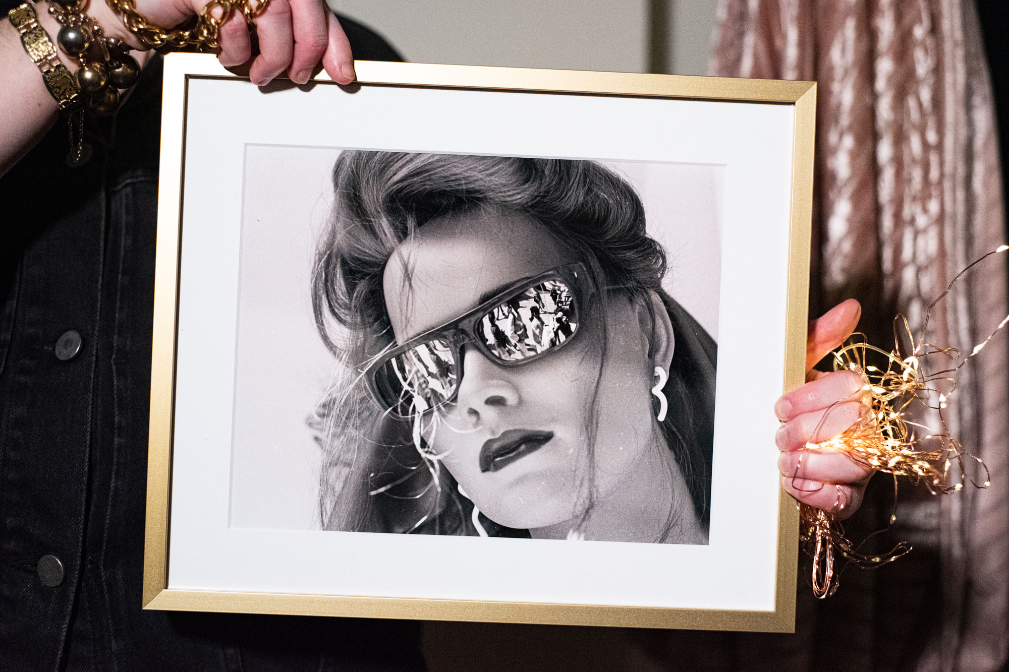 framed photograph of a sunglass-wearing mannequin