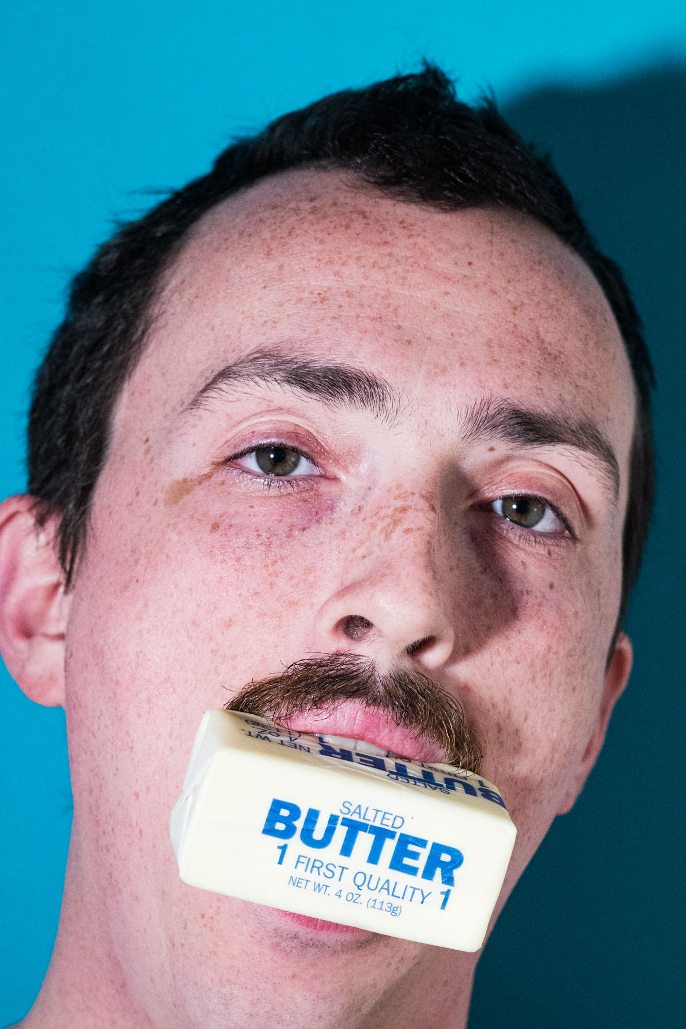 man eats butter