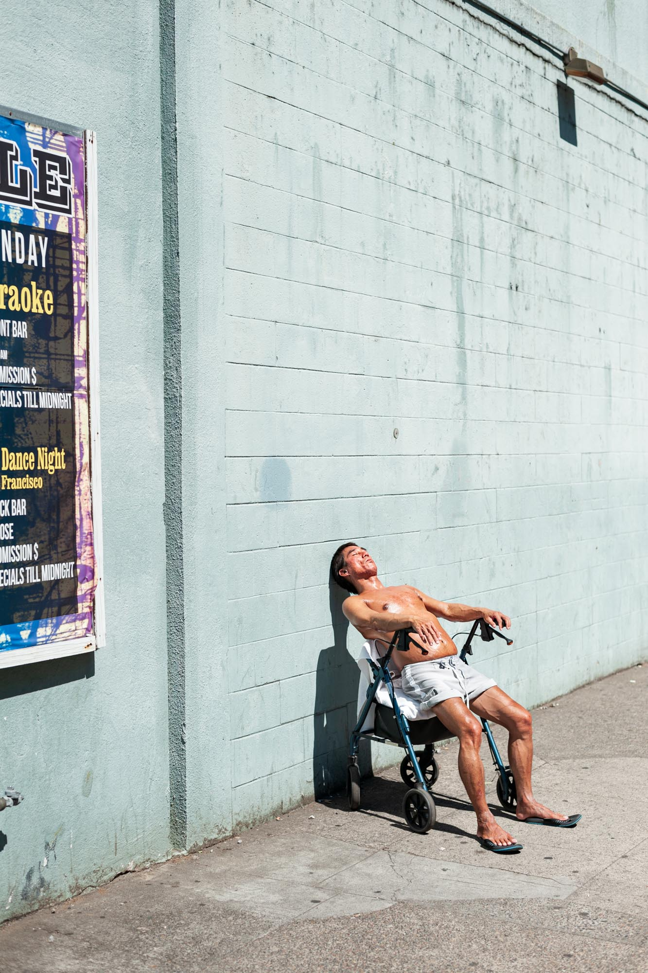 a man tanning in the city