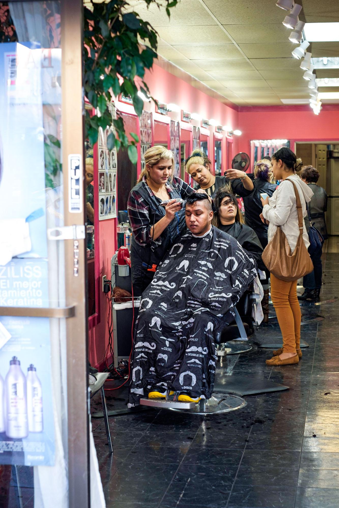 peeking inside a barbershop