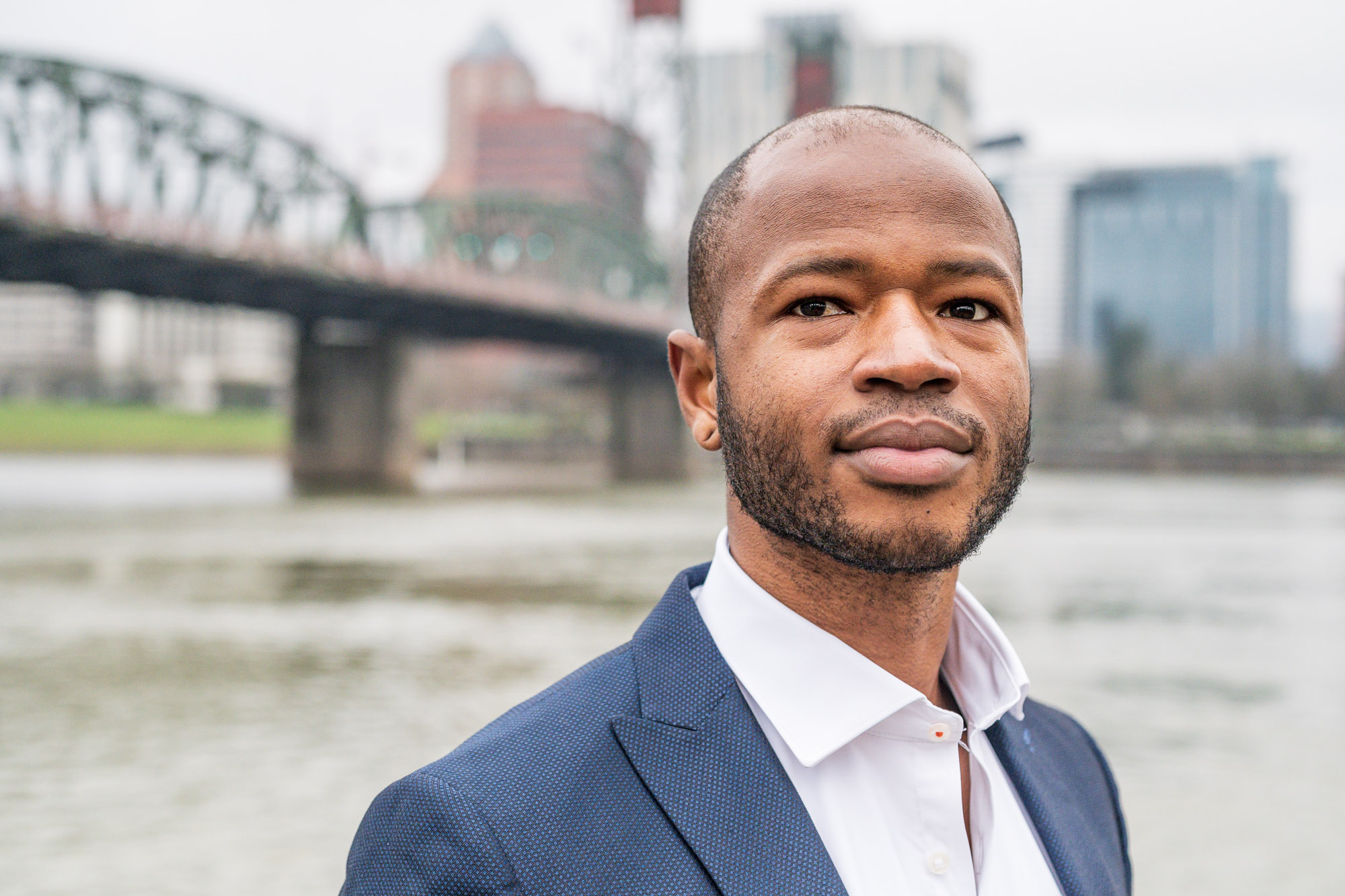 a candidate for Metro Council stands on Portland's waterfront