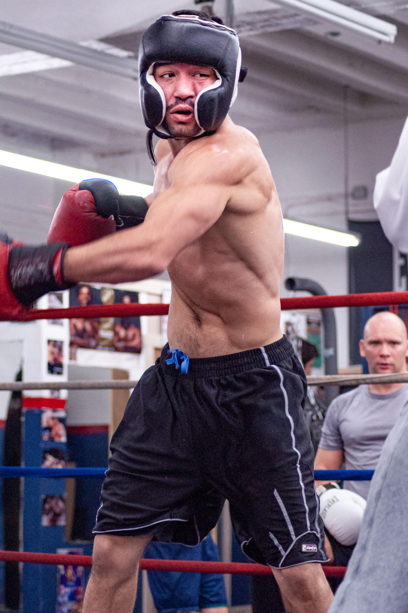 a boxer misses on a big left hook