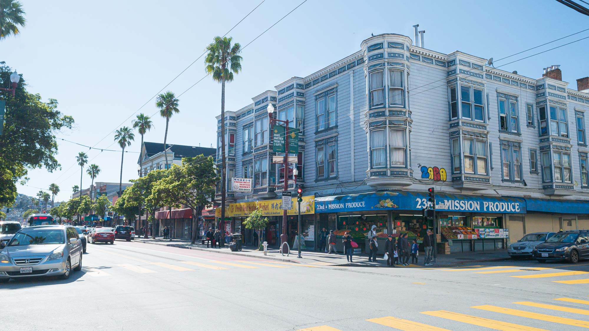 a busy street corner in The Mission in San Francisco, CA