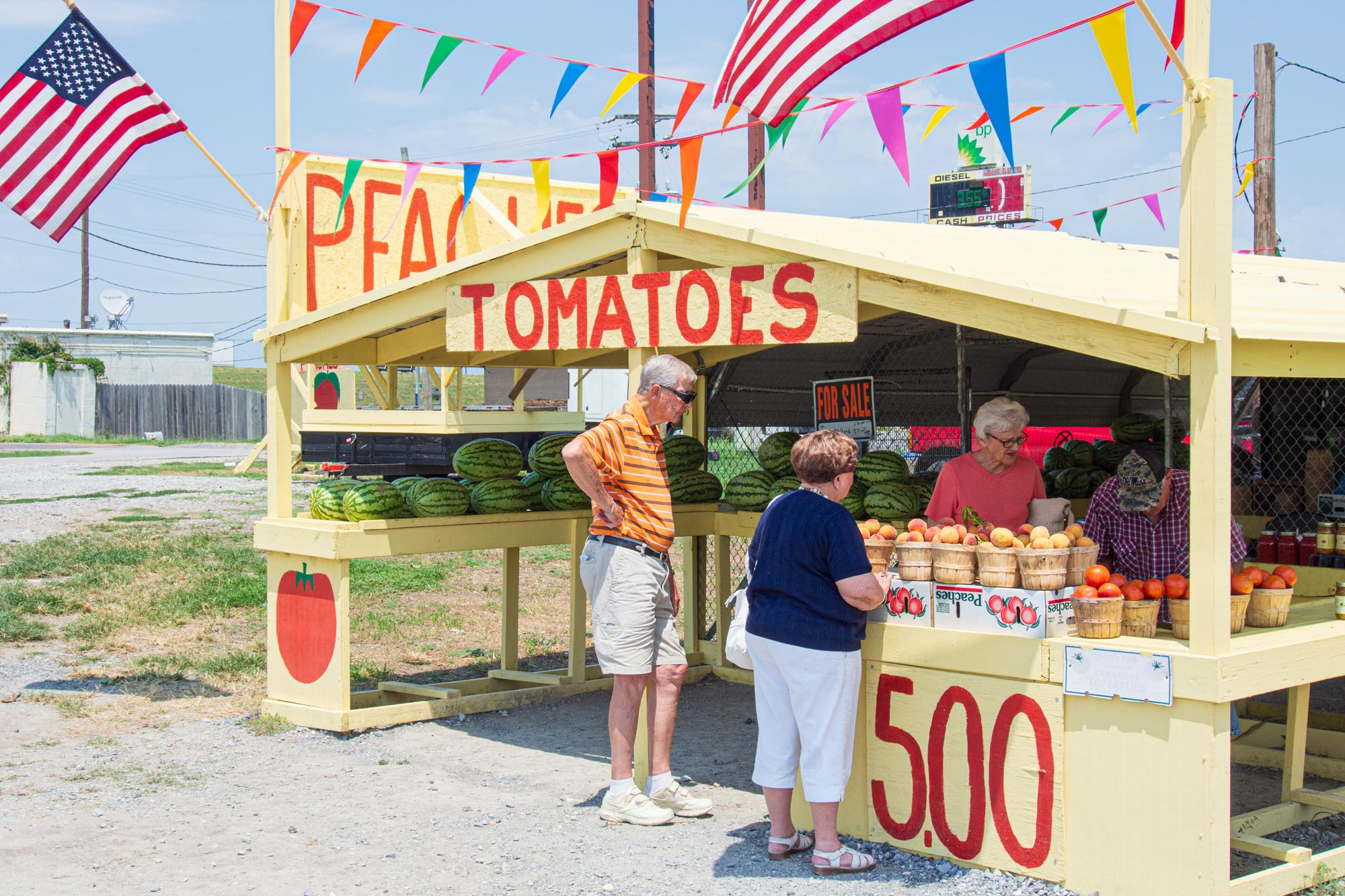 two customers buy produce at a stand in rural Arkansas