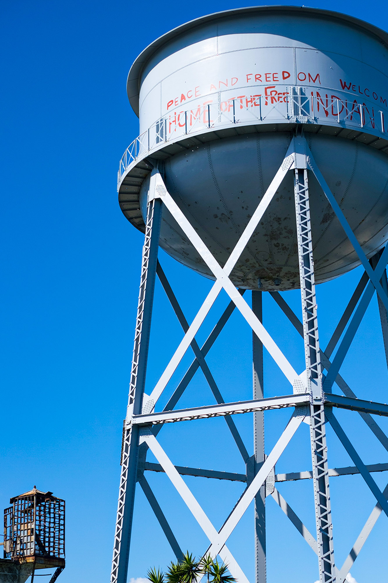 a water tower displays protest messages on Alcatraz Island in California