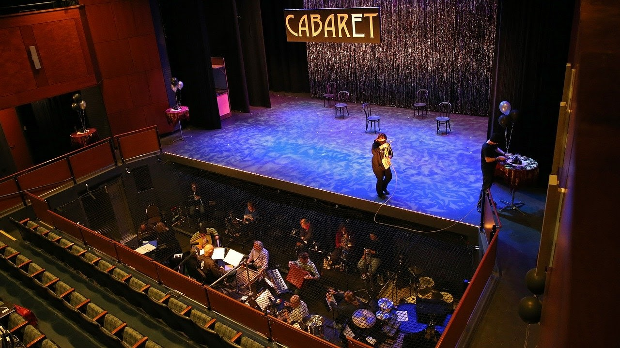 An orchestra settles in before a production of Cabaret.