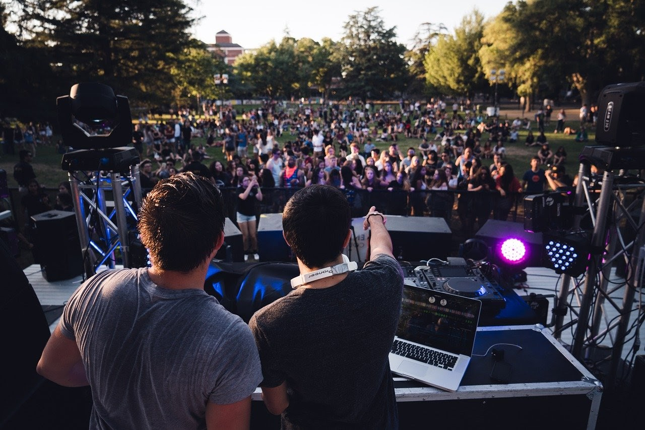 Two DJ's play to a crowd at a music festival, organized by a music intern in Pittsburgh.