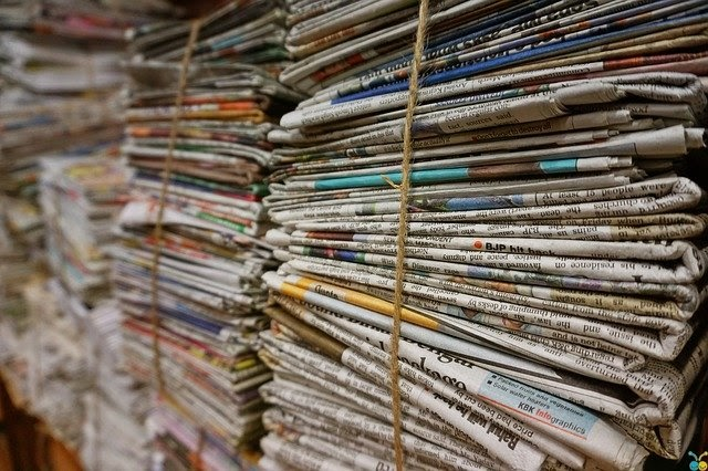 Stacks of newspapers are tied up with string and serve as great content inspiration