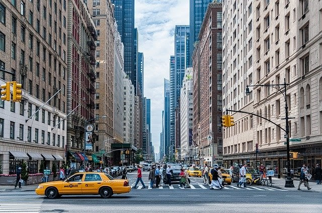 A picture of a busy street in New York City with many different people, for whom one generic email blast would not be effective