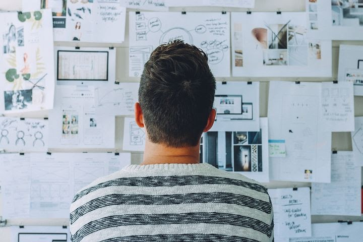 a man studies his notes and startup plans