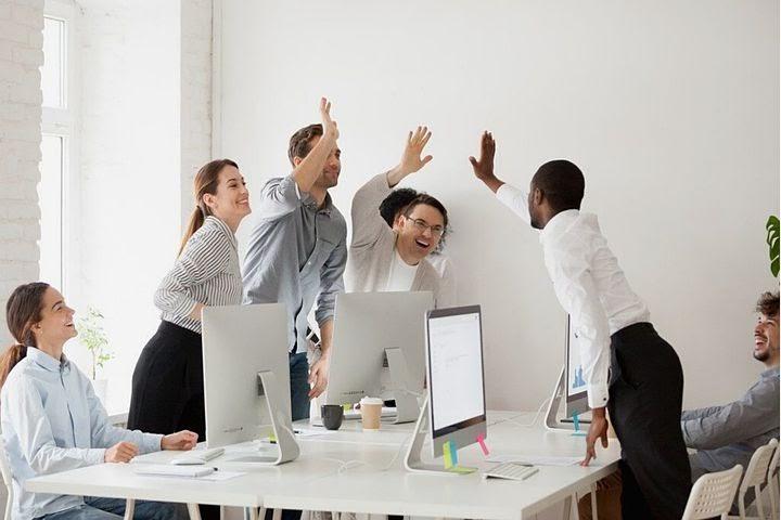 a team celebrates success
