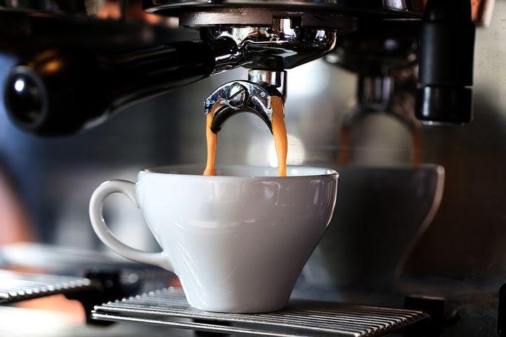 a coffee machine brews a midday latte