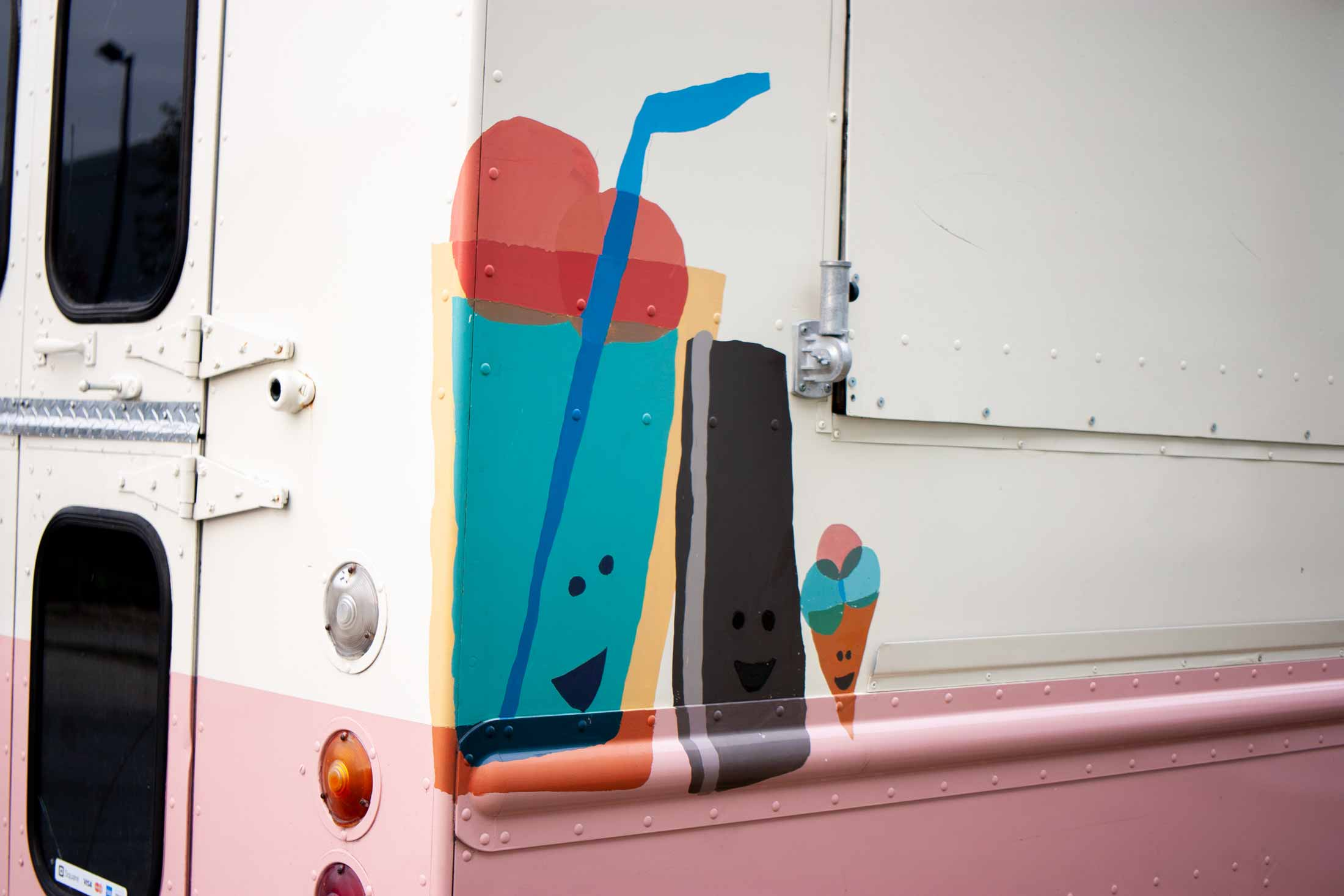 The opposite side of the truck featured illustrations of an ice cream float, sandwich and cone — by Yagnyuk.