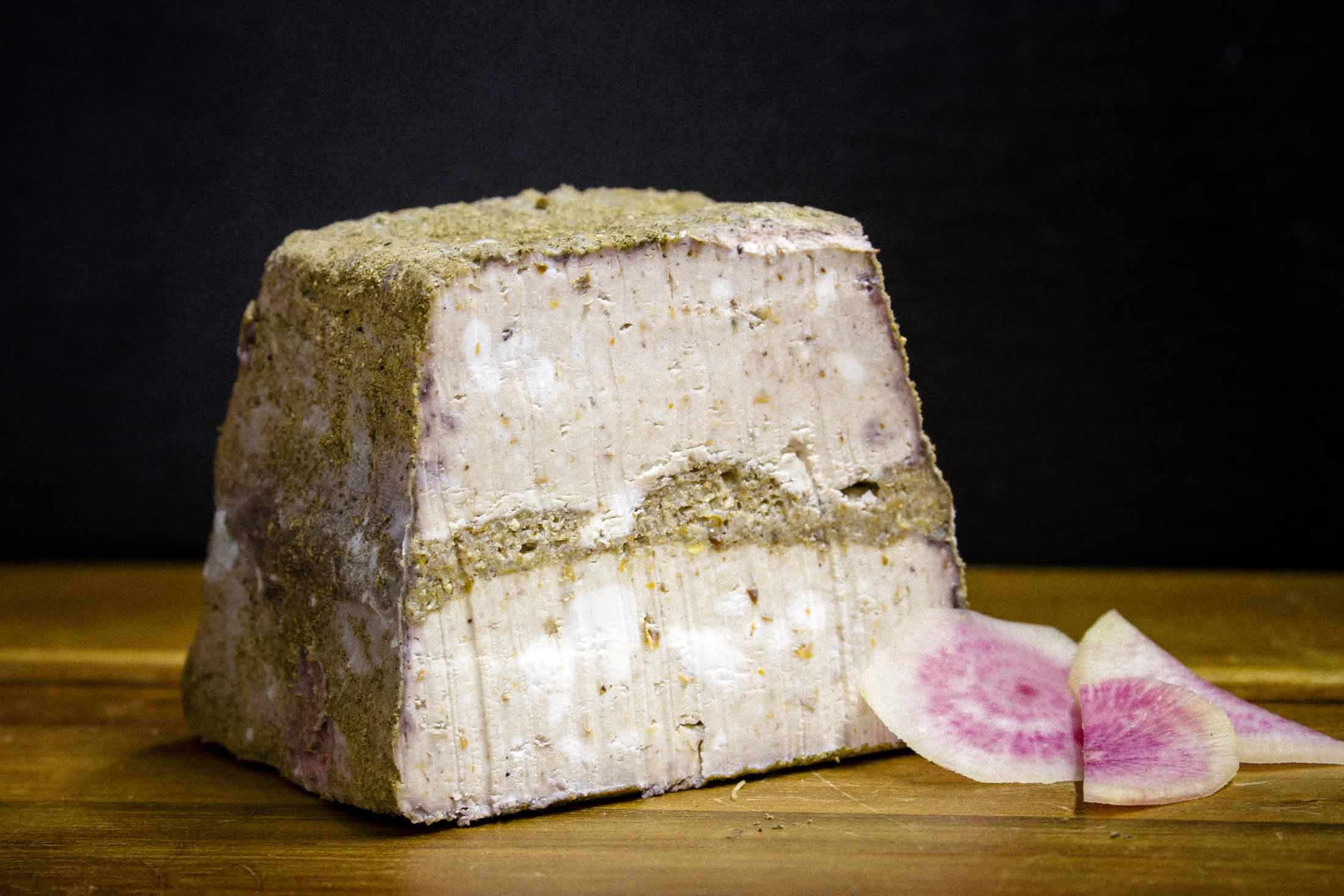 Layer cheese block with slices of watermelon radish — Yagnyuk.