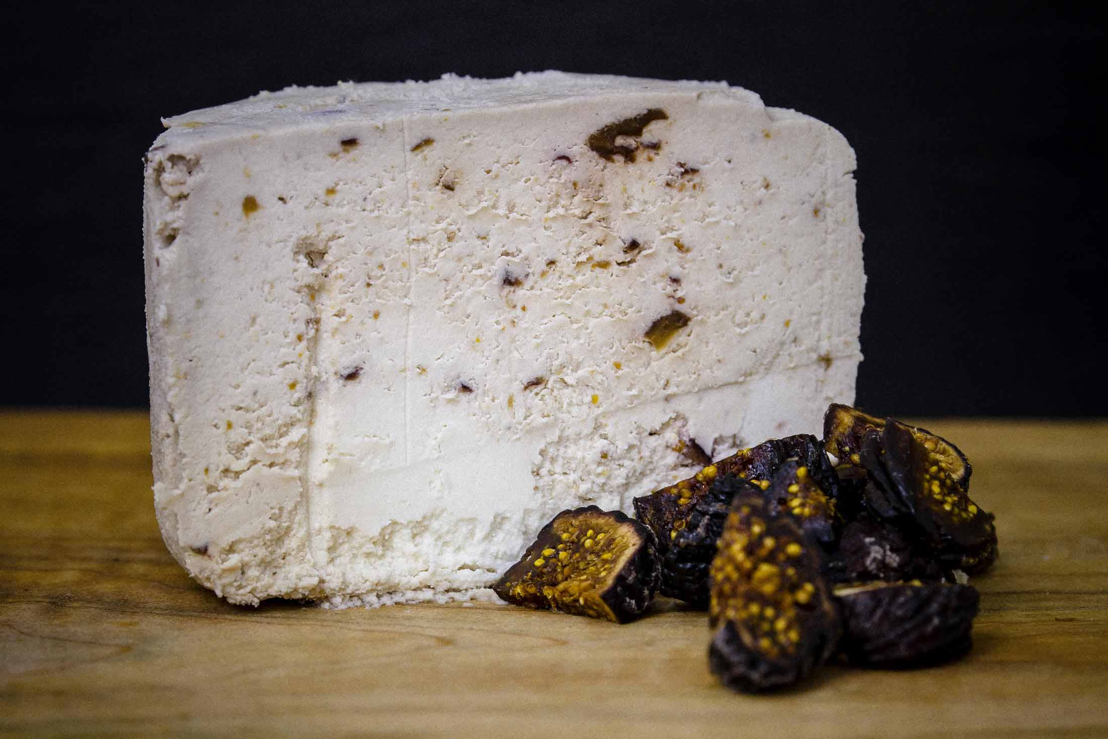 Close up photograph of black fig infused cheese Fig Cumulus — Yagnyuk.