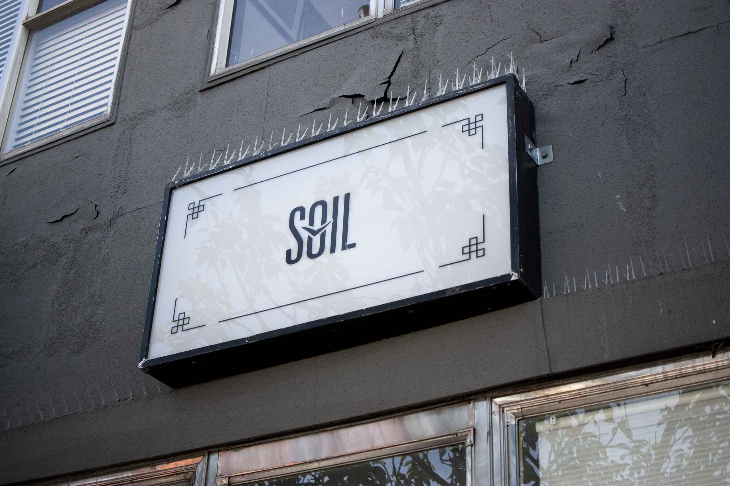 SOIL Restaurant Lightbox featuring the logo and decorative detailing in the corner — by Dima.