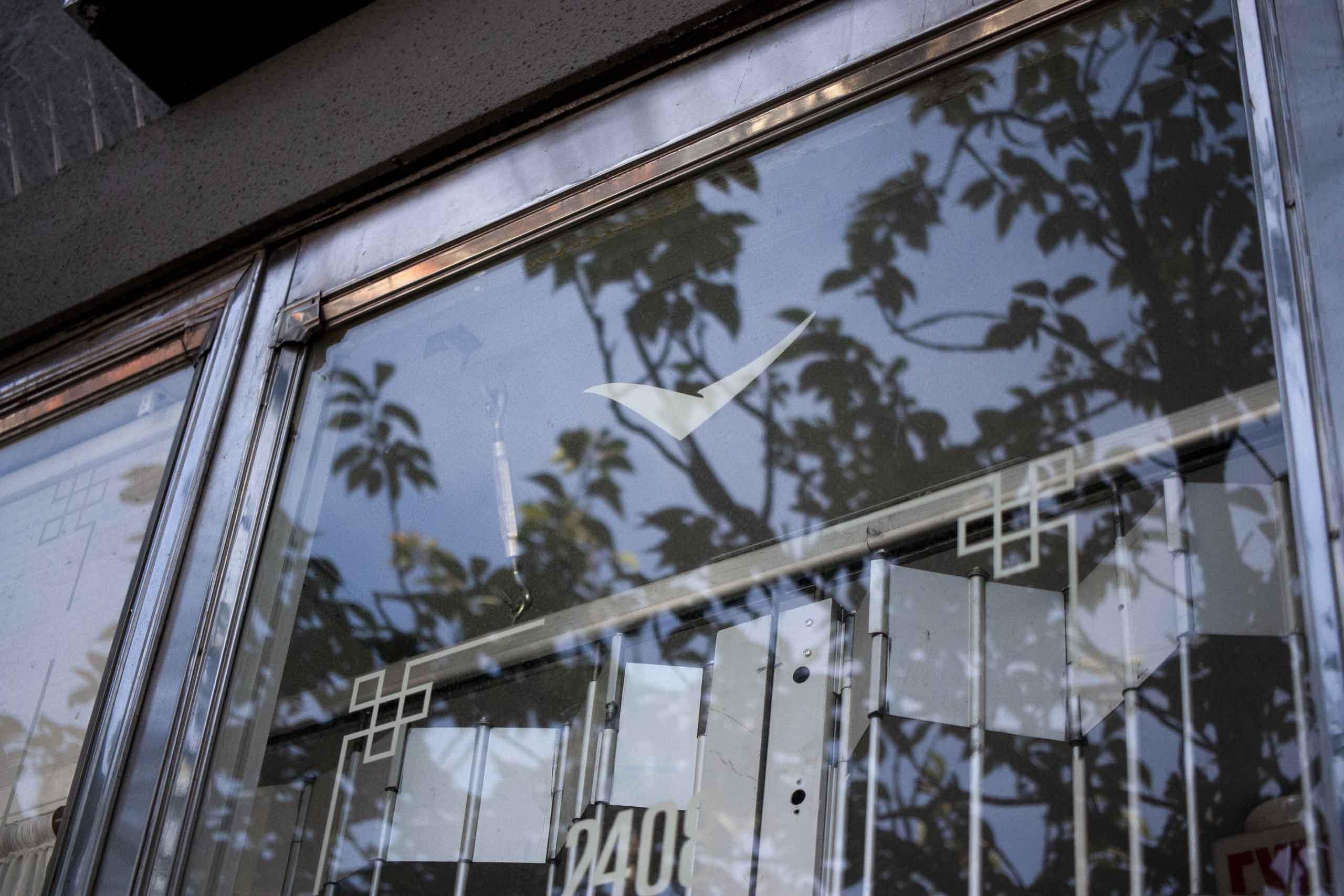 Handpainted blue Heron Logo on the window — by Yagnyuk.