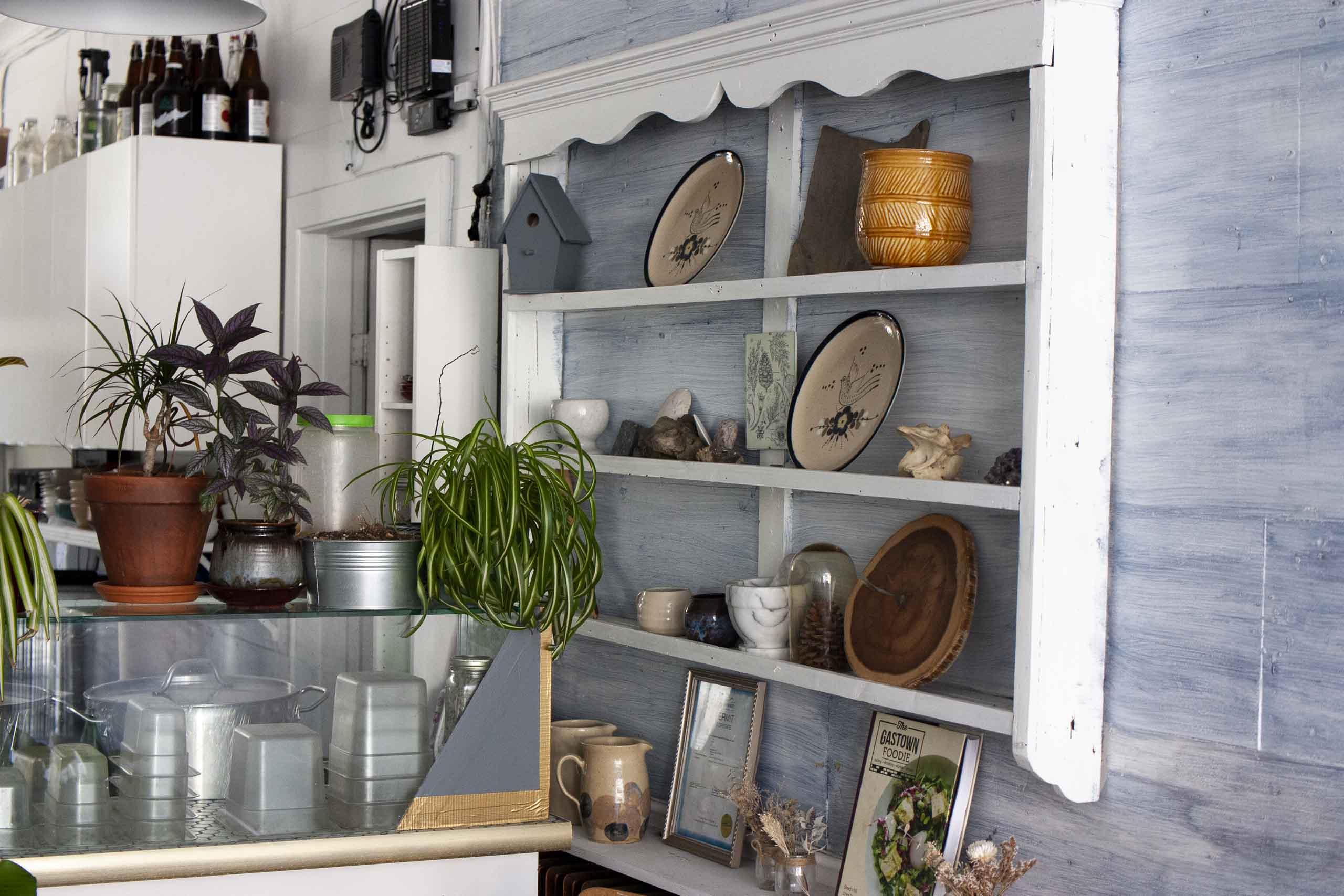 SOIL Restaurant Interior, shelves with plates — by Dima Yagnyuk.