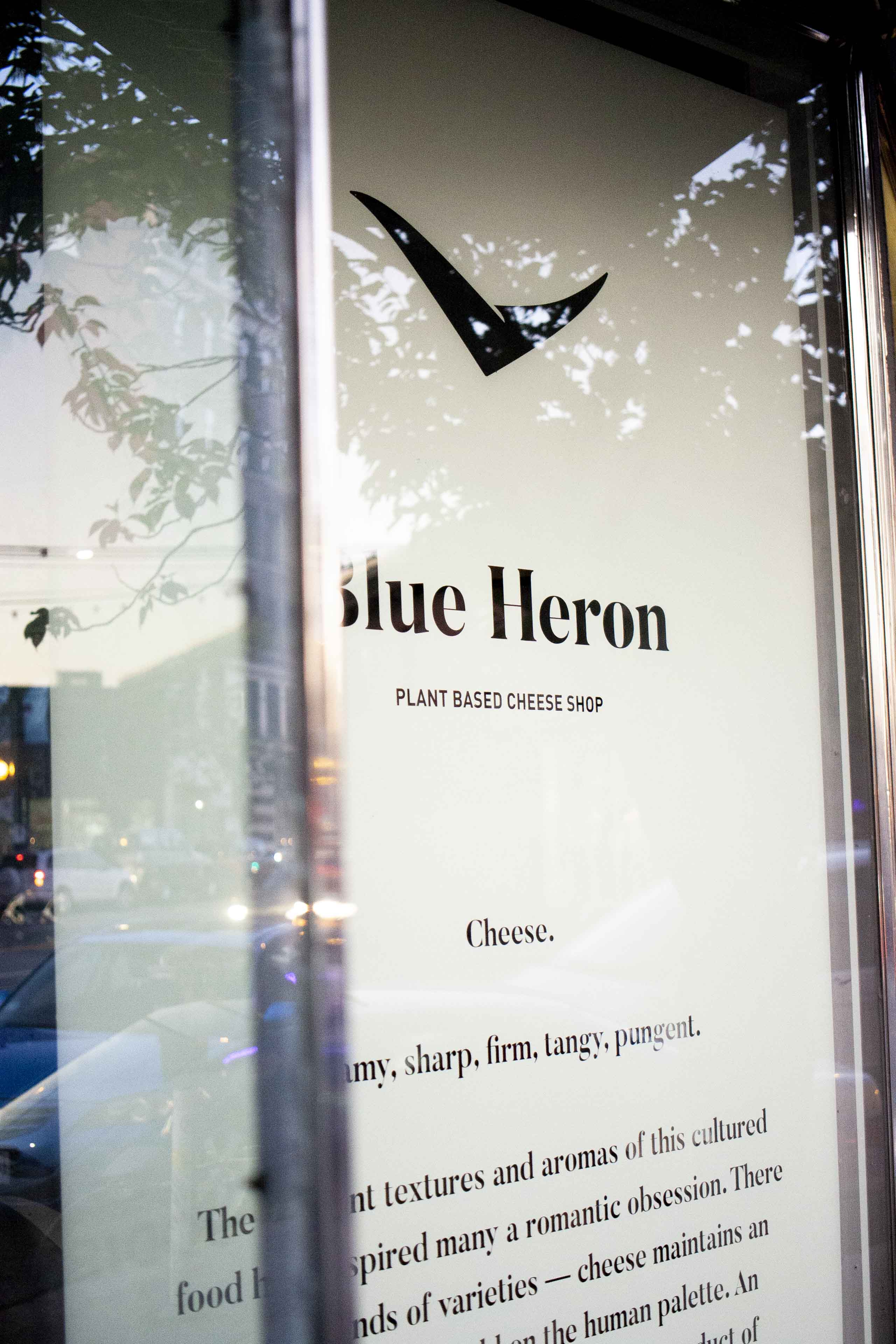 Blue Heron brand manifesto hand painted on the main window — by Yagnyuk.