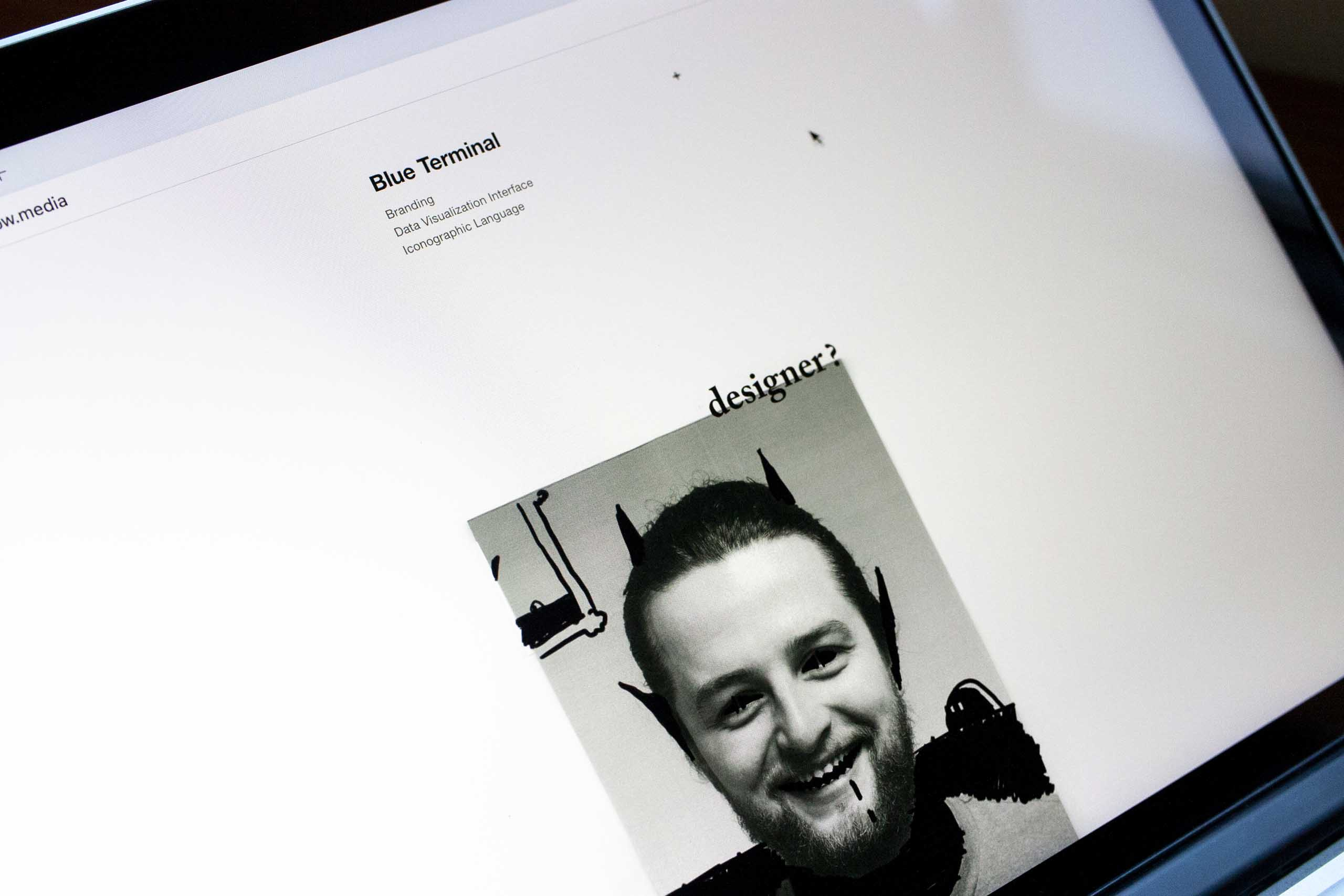 "Bottom of the Pilcrow Media website showing a photo of the ""devil"" variant of the job advertising poster — by Dima Yagnyuk."