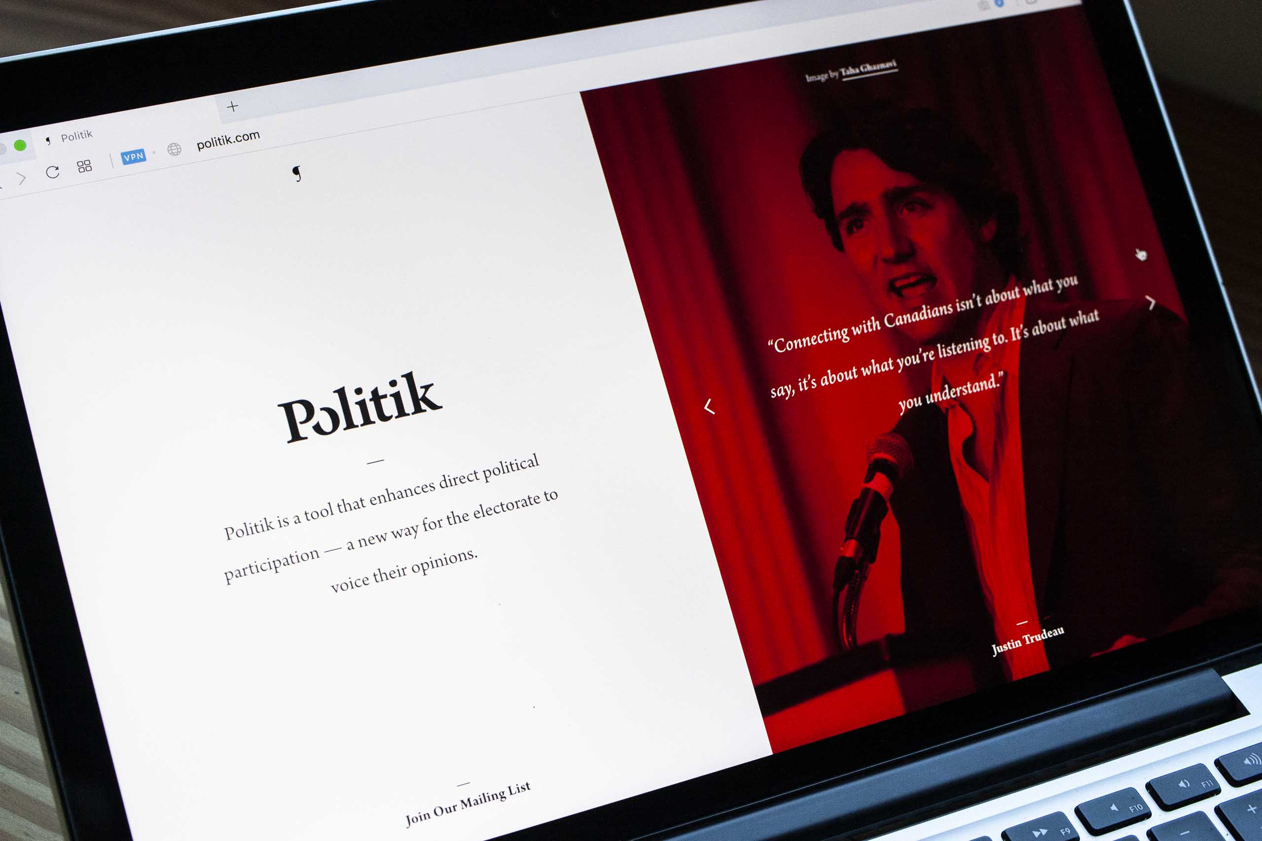 Neon red Politik page featuring photo and quote from Justin Trudeau — by Yagnyuk.