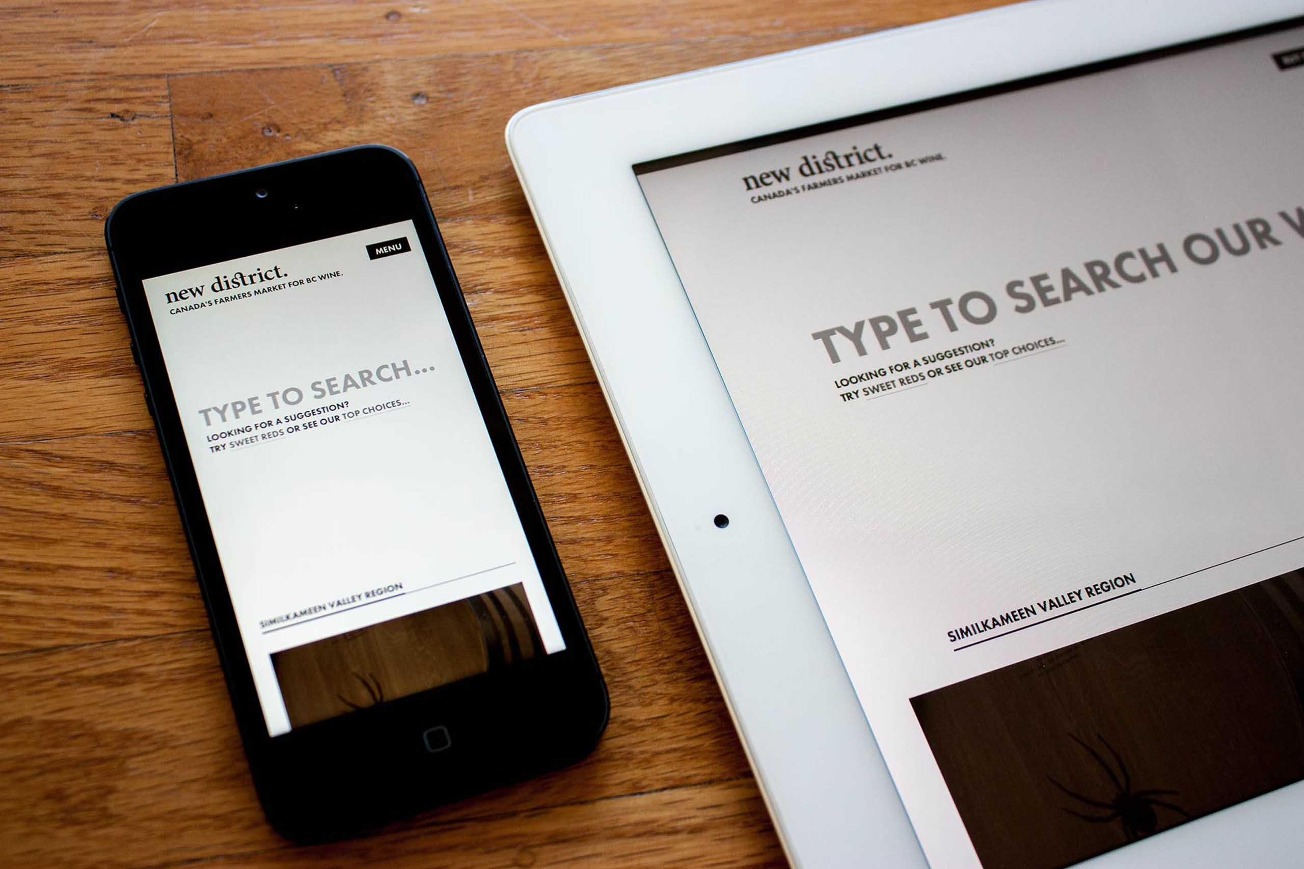 New District E-Commerce website homepage, showing prominent search focused page on mobile and table devices — by Yagnyuk.