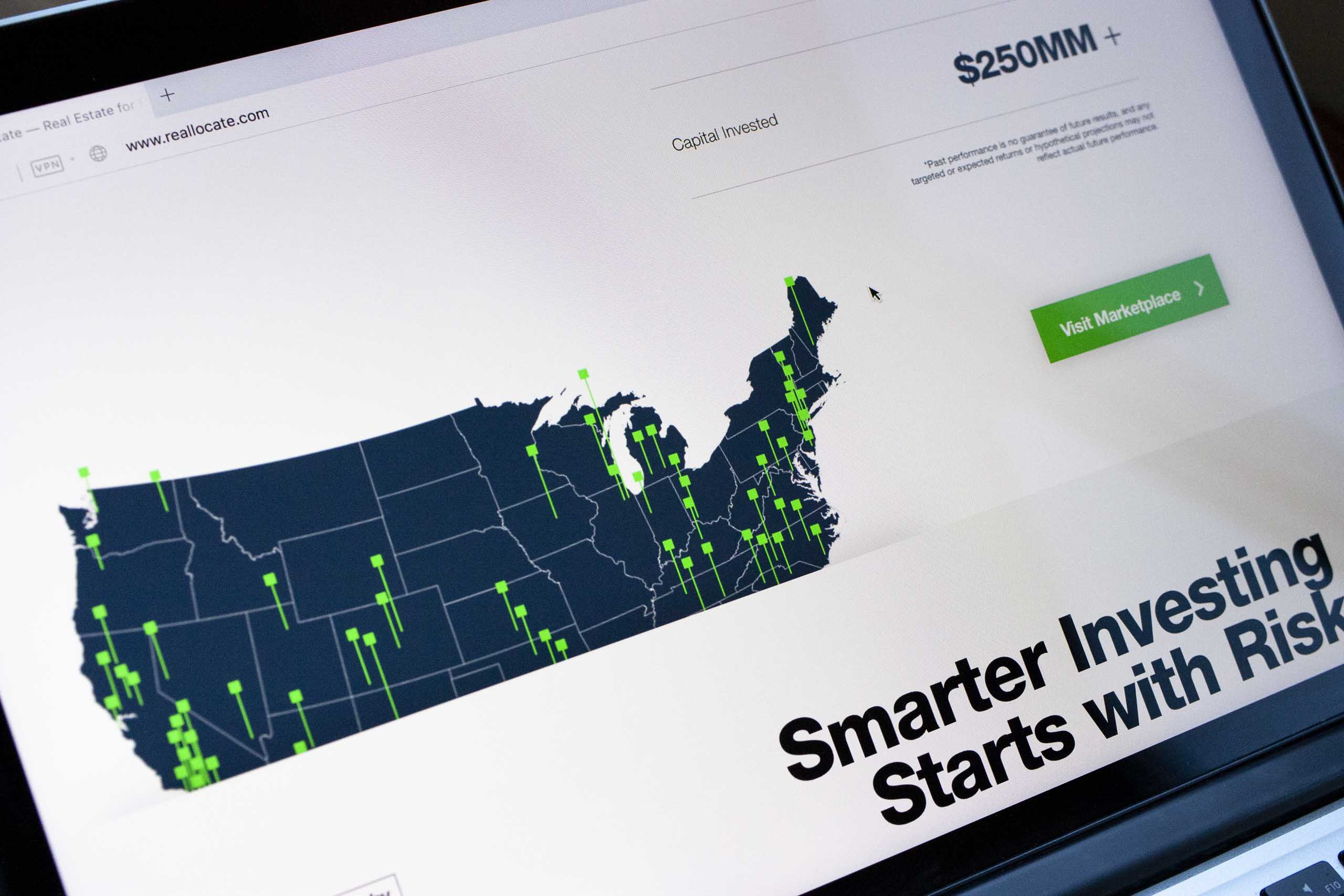 "A close of up of ""Smarter Investing"" section with a map of United States with a neon green pin for each property from RealCrowd — by Dima Yagnyuk."